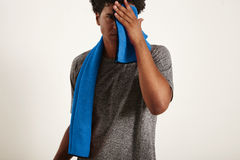Young black sportsman wiping his face with a towel Royalty Free Stock Image