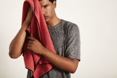 Young black sportsman wiping his face with a towel royalty free stock photography