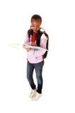 Schoolgirl reading. Stock Photo