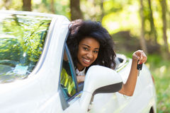 Young black teenage driver holding car keys driving her new car Royalty Free Stock Photography