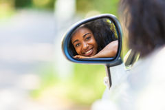 Young black teenage driver seated in her new convertible car - A Royalty Free Stock Image