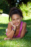 Young black teenage girl  lying on the grass. Young african american teenage girl  lying on the grass Royalty Free Stock Photography