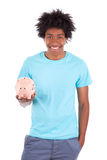 Young black teenage men holding a piggy bank - African people Stock Photos