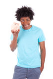 Young black teenage men holding a piggy bank - African people Royalty Free Stock Photography