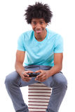 Young black teenage men playing video games - African people Stock Photography