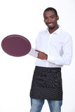 Young black waiter Royalty Free Stock Images