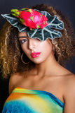 Young black woman with afro hairstyle and make up . Elegant diadem with dragon fruit, Stock Image