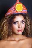 Young black woman with afro hairstyle and make up . Ethnic woman with flower and fruit diadem. royalty free stock photo