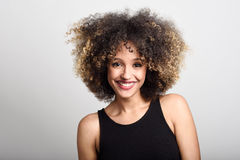 Young black woman with afro hairstyle smiling Stock Image