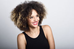Young black woman with afro hairstyle smiling Stock Photos