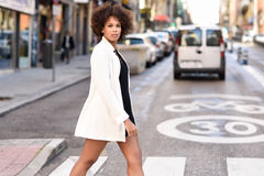 Young black woman with afro hairstyle standing in urban background royalty free stock photos