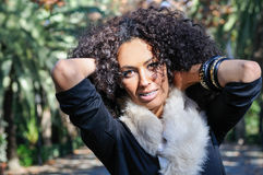 Young black woman, afro hairstyle, in urban background. Portrait of a young black woman, afro hairstyle, in urban background Royalty Free Stock Photo