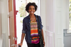 Young black woman arriving home stock photography