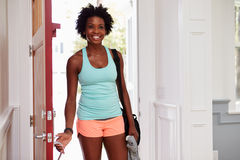 Young black woman arriving home after exercising Stock Photos
