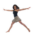 Young Black Woman in Big Jump Action Shot. Young black woman in skirt and black top jumping Royalty Free Stock Photo