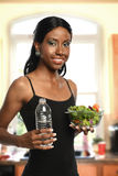 Young Black woman with bowl of salad Royalty Free Stock Photography