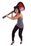 Young black woman breaking a guitar Royalty Free Stock Images