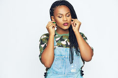 African-American woman in casual clothes touching ears Royalty Free Stock Images