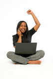Young black woman with computer and cell phone. Stock Photos
