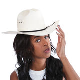 Young Black woman in a cowboy hat. Thoughtful young African American woman wearing a white cowboy hat Royalty Free Stock Photos