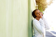 Young black woman enjoying listening to music with headphones Stock Photo