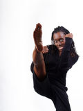 Young black woman fighting stance kick leg up Stock Photo