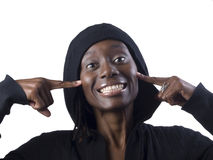Young black woman with fingers pointing at cheeks Stock Images