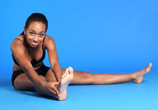Young black woman hamstring stretch exercise Royalty Free Stock Photos