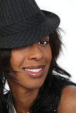 Young Black woman in a hat. African American young woman wearing a black hat Stock Photos