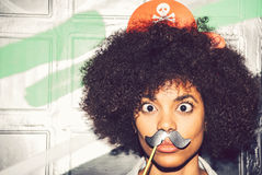 Young black woman having fun with a fake mustache Royalty Free Stock Photography