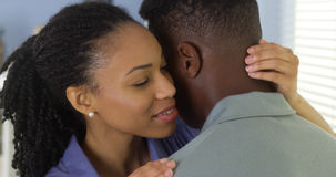 Young Black woman holding boyfriend Royalty Free Stock Image