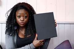Young Black Woman Holding Small Black Board Royalty Free Stock Image