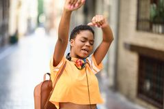 Free Young Black Woman Is Dancing On The Street In Summer. Girl Traveling Alone. Royalty Free Stock Images - 154324549
