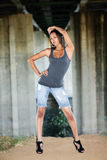 Young black woman in jeans cutoff shorts. Young African American woman in cutoff jeans outdoors royalty free stock photography