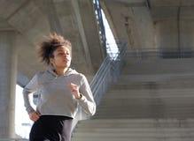 Young black woman jogging outdoors Stock Photos