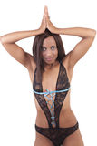 Young black woman in lacy lingerie standing Stock Photography
