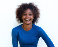 Young black woman laughing against white background Stock Photo