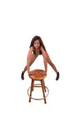 Young black woman leaning on stool in lingerie Royalty Free Stock Photos