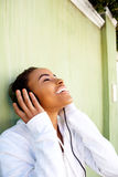 Young black woman listening to music with headphones Royalty Free Stock Photo