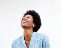 Young black woman looking away and laughing Royalty Free Stock Images