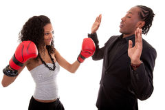 Young black woman and men boxing Royalty Free Stock Image