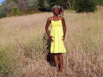 Young black woman outdoors in yellow dress. Outdoor black woman in yellow dress eyes closed Stock Photos