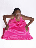 Young black woman in pink dress hands on knees Royalty Free Stock Image