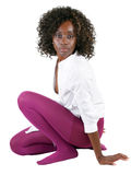 Young black woman in purple tights white shirt Royalty Free Stock Photos