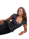 Young black woman reclining on floor cleavage Stock Photos