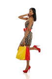 Young Black Woman with shopping bags Stock Photos