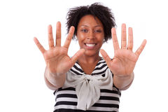Young black woman showing her  hands palm - African people Royalty Free Stock Images