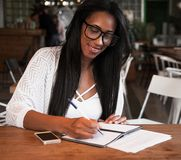 Free Young Black Woman Sitting At Cafe And Writing Notes, Lifestyle Concept Royalty Free Stock Photo - 116280865