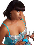Young black woman sitting in blue lingerie Stock Images