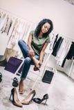 Casual woman choosing trendy heels in shop royalty free stock photos